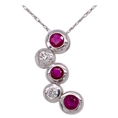 14kt Gold Ruby and Diamond Necklace Having 3 Rubies and 2 Round Diamonds