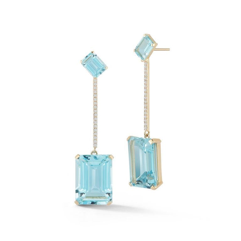 Beautifully made in New York of solid 14kt yellow gold, emerald cut blue topaz  and set with brilliant diamonds.  These strikingly beautiful earrings are the perfect way to add color to ones look and stand out.