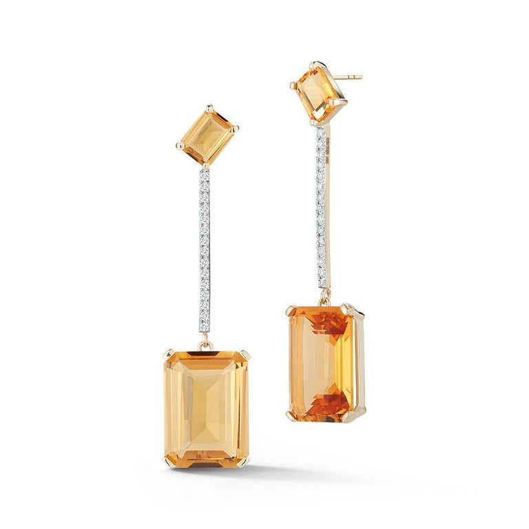 Beautifully handcrafted in New York of solid 14kt yellow gold, emerald cut citrine of two shades with brilliant diamonds.  These strikingly beautiful earrings are the perfect way to add color to ones look and stand out.