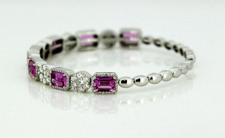 Women's 14 Karat White Gold Bangle with Natural Pink Sapphires and Diamonds For Sale