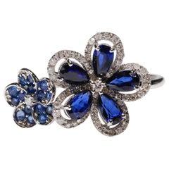 14 Karat White Gold Blue Sapphire 0.29 Carat Diamond Double Flower Bridal Ring