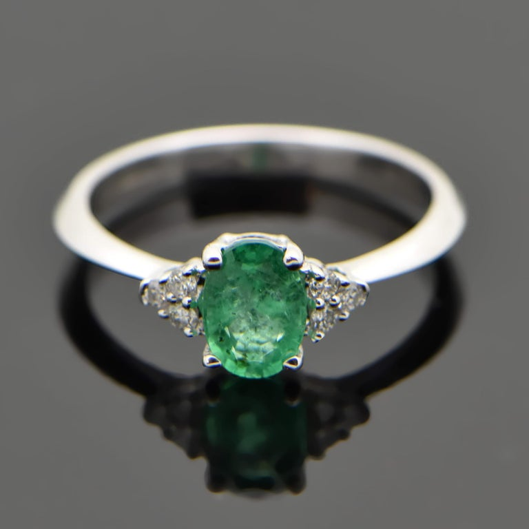 Oval Cut 14 Karat White Gold Emerald and Diamond Ring For Sale