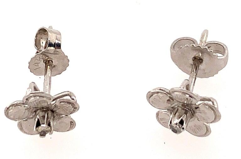 Women's 14 Karat White Gold Flower Stud Earrings with Round Diamond For Sale