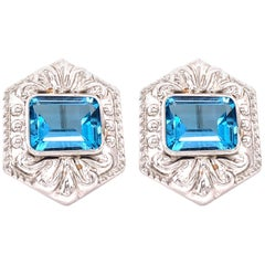 14 Karat White Gold French Back Huggie Earrings with Blue Topaz