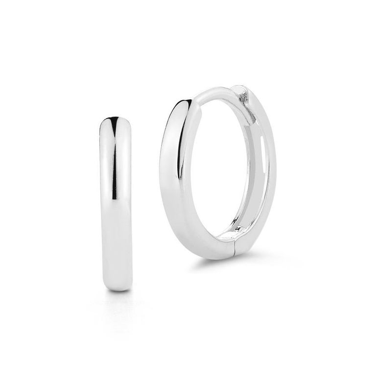 Beautifully made in New York of 14kt white gold with a hinge and snap closure. They are perfect for every day wear. One almost will forget they have them on.  Looks fantastic layered or worn on its own.