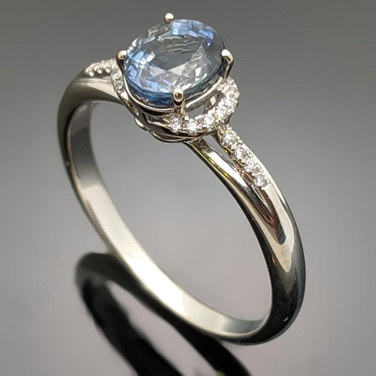 A 14kt white gold ring featuring a blue sapphire with an estimated weight of 0.59ct and side diamonds with an estimated 0.06cttw. Estimated weight of gold is 2 gr.  We size it for you
