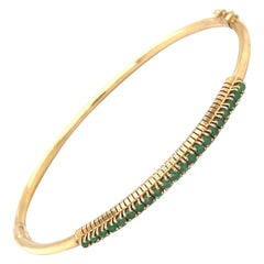 14kt Yellow Gold and Emerald 0.90ct. Bangle Bracelet