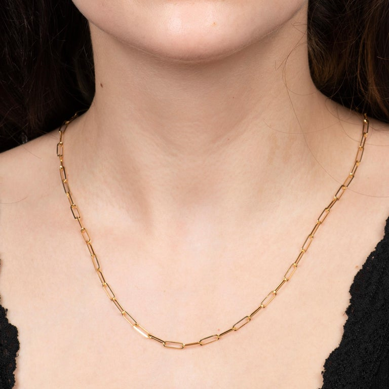 This simple necklace is a 14kt yellow gold, 18 inch paperclip chain necklace. It is the perfect necklace for layering!