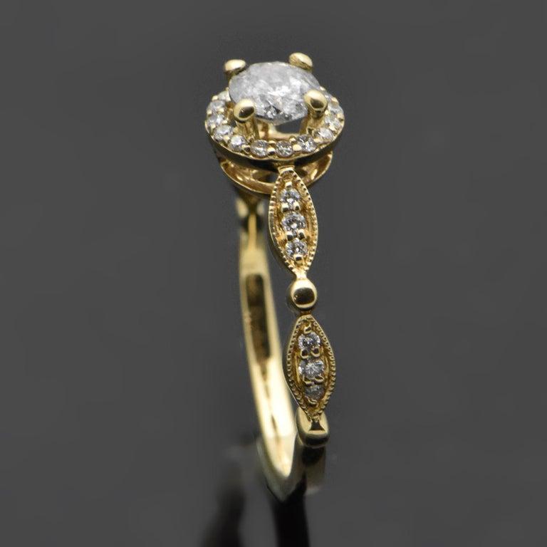 Round Cut 14 Karat Yellow Gold Diamonds Ring For Sale