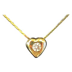 14kt Yellow Gold Heart Pendant with Diamond and Sapphire Center