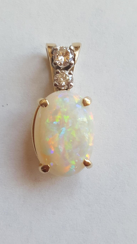 Contemporary 14 Karat Yellow Gold Oval Opal, Round Brilliant Diamond Three-Stone Pendant For Sale