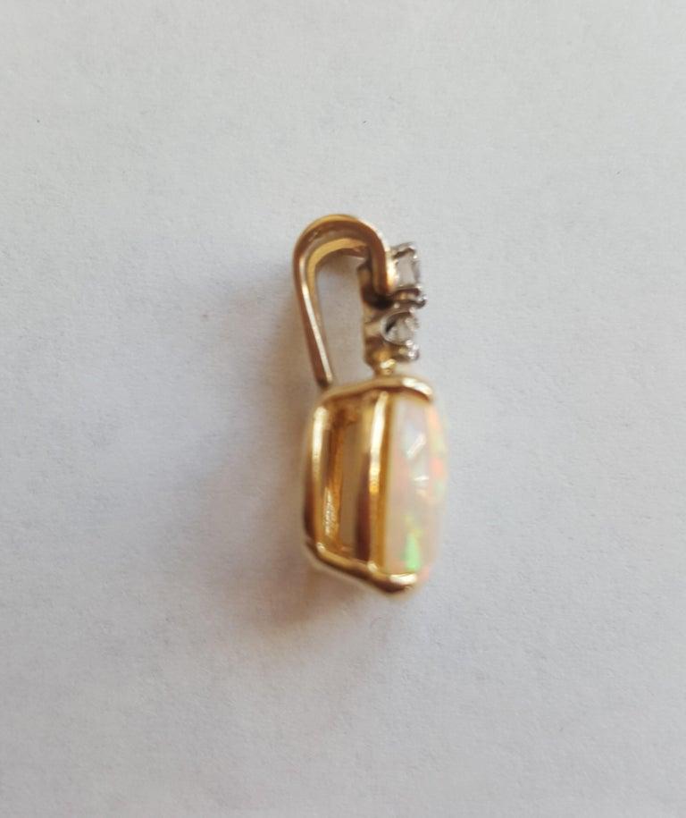 Oval Cut 14 Karat Yellow Gold Oval Opal, Round Brilliant Diamond Three-Stone Pendant For Sale