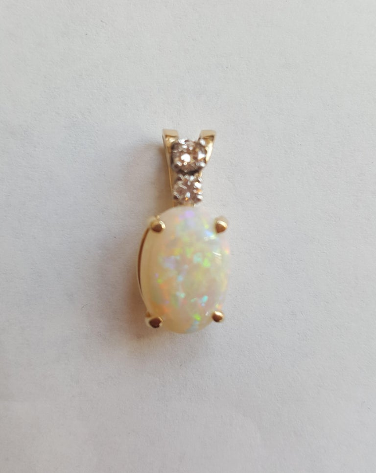 Women's or Men's 14 Karat Yellow Gold Oval Opal, Round Brilliant Diamond Three-Stone Pendant For Sale