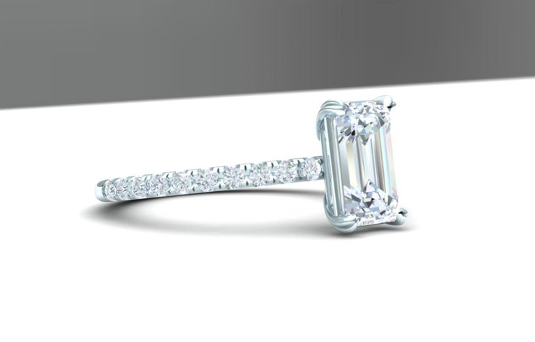 Here is a simple but stunning diamond ring that anyone would be excited to open.  The center stone is a emerald cut that is GIA certified and weighs 1.5 carats and a color and clarity of H-VS2.  The center stone is set in a 18k white gold mounting