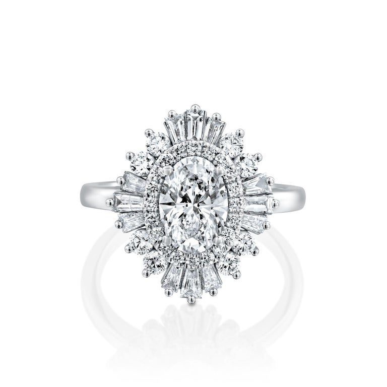 Beautiful solitaire with accents Gatsby style GIA certified diamond engagement ring. Ring features a 3/4 carat oval cut 100% eye clean natural diamond of F-G color and VS2-SI1 clarity and it is surrounded by smaller natural diamonds of approx. 3/4