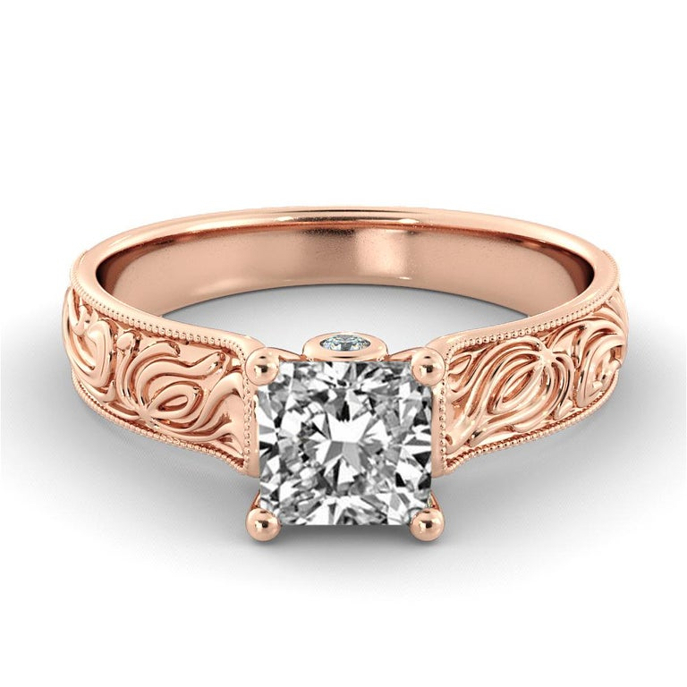 This breathtaking hand engraved vintage style ring features a solitaire GIA certified diamond. Ring features a 1.5 carat princess cut 100% eye clean natural diamond of F-G color and VS2-SI1 clarity accompanied by smaller natural diamonds off approx.