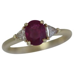 1.5 + Carat Oval Natural Ruby and Diamond Ring Set in 18 Karat Yellow Gold