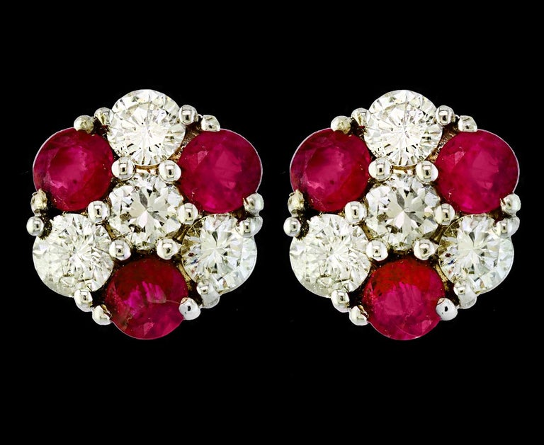 1.5 Carat  Round Cut Ruby  perfect pair  Post  Earrings  14 Karat  Yellow Gold  This exquisite pair of earrings are beautifully crafted with 14 karat  Yellow gold . Weight of 14 K gold 5.3 grams  Fine  6 Round Cut Ruby weighing approximately 1.5