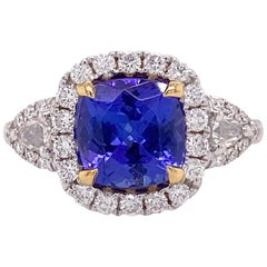 1.5 Carat Tanzanite Halo Ring, .50 Carat Diamond and Tanzanite Halo Ring