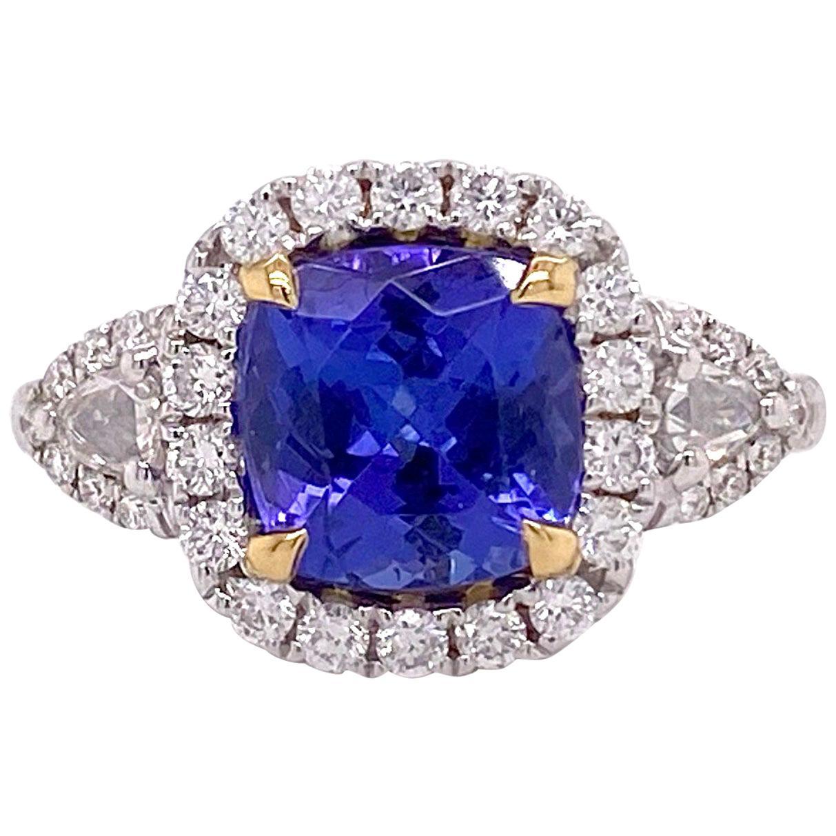 1.5 Carat Tanzanite Halo Ring, .50 Carat Diamond and Tanzanite Halo Ring