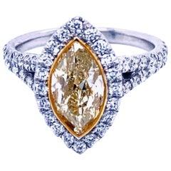 1.5 Carat Yellow MQ Diamond in Pave Set 18 Karat Split Shank Ring with Halo
