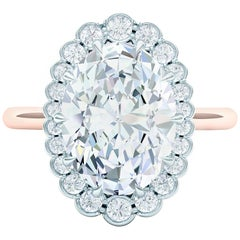 1.5 GIA Certified Oval Diamond Set in Platinum and Rose Gold Engagement Ring