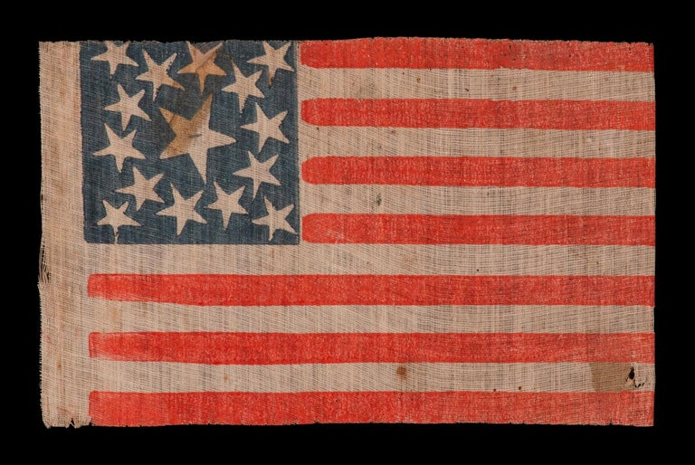 15 Stars on an Antique American Flag Made Either to Celebrate Kentucky Statehood, or to Glorify The South, 1861-1865, a Very Rare Example with Great Folk Qualities  15 star American parade flag with 13 stripes, printed on coarse, glazed cotton.