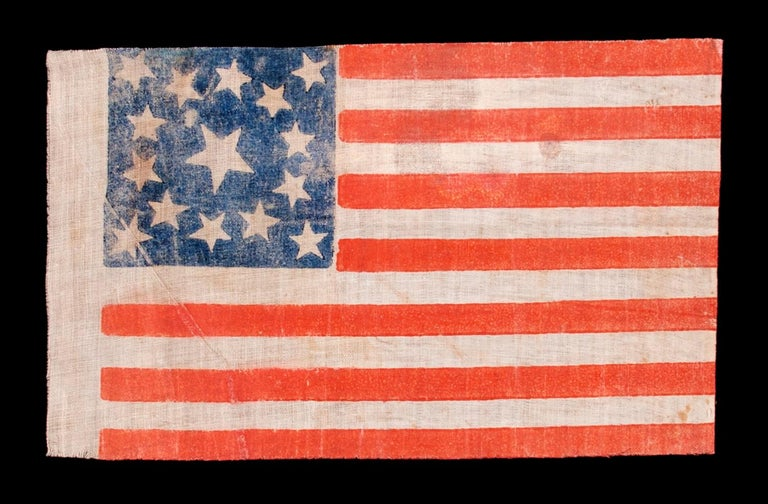 15 STARS, MADE EITHER TO CELEBRATE KENTUCKY STATEHOOD OR TO GLORIFY THE SOUTH, 1861-1876, A VERY RARE EXAMPLE   15 star American parade flag with 13 stripes, printed on coarse, glazed cotton. The stars are arranged in a medallion configuration that