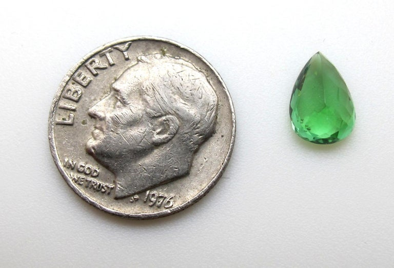 This bright bluish-green Pariaba tourmaline measures 9.03 x 6.22 x 4.21 millimeters and weighs 1.50 carats. It is accompanied by Gemological Institute of America Certification #2205186974 that lists it's origin as Brazil. Brazilian Paraiba