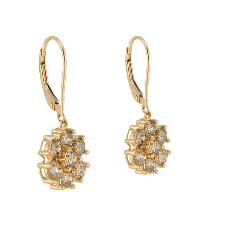 Diamond flower dangle earrings. Natural 14 round brilliant cut champagne diamonds in a flower design, 14k yellow gold.   14 round brilliant cut champagne diamonds, approx. total weight 1.50cts. SI Stamped: 14k yellow gold Top to bottom: 25.6mm or 1