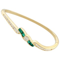 1.50 Carat Emerald and 1.36 Carat Diamond Bangle in Yellow Gold