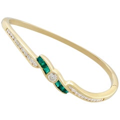 1.50 Carat Emerald and 1.36 Carat Diamond Bangle in Yellow Gold