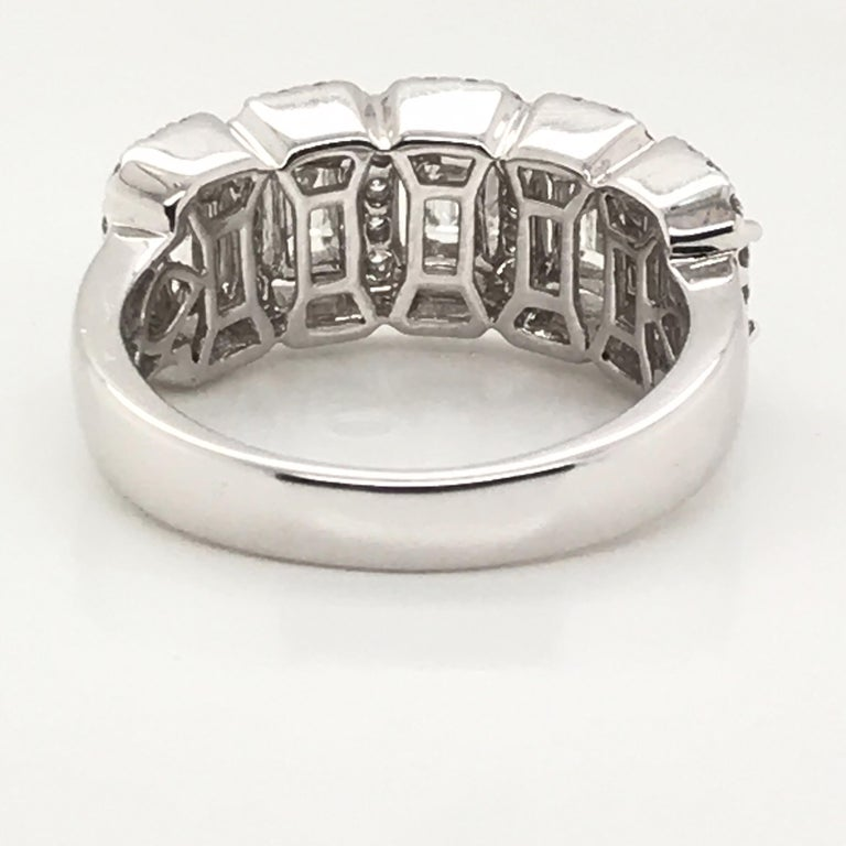 HJN Inc. Ring featuring an Emerald-Cut and Round Diamond Ring  Emerald-Cut Diamond Weight: 1.00 Carats Round-Cut Diamond Weight: 0.50 Carats  Total Stones: 69 Clarity Grade: SI1 Color Grade: H Total Diamond Weight: 1.50 Carats Polish and Symmetry: