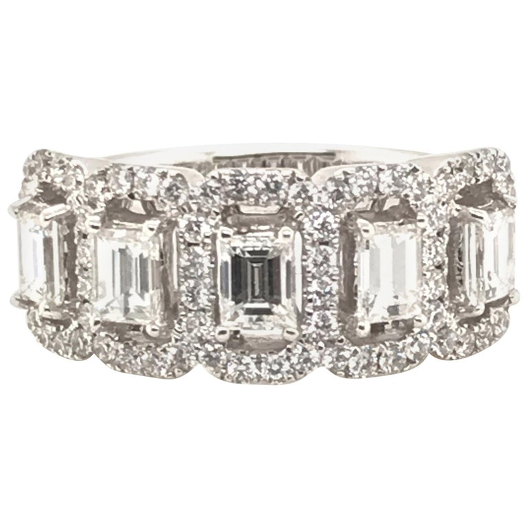 1.50 Carat Emerald Cut and Round Diamond Ring For Sale