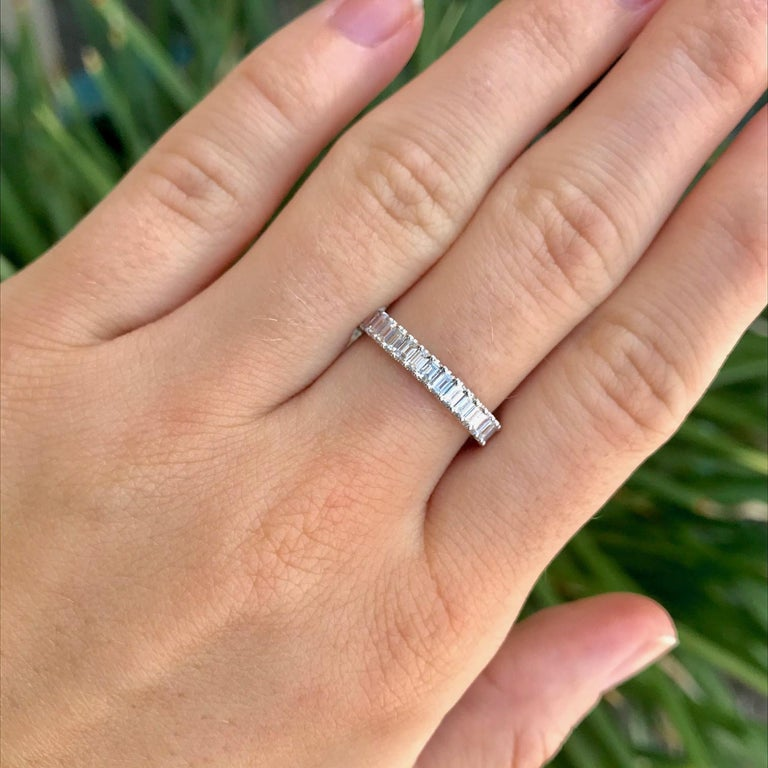 This gorgeous, sleek diamond band is an eternity design with natural diamonds going all the way around the band. The most unique feature of this diamond eternity band is the cut of the diamonds. These diamonds are emerald cut! Most eternity bands