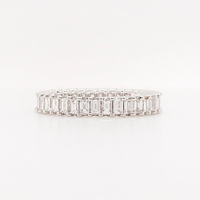 1.50 Carat Emerald Cut Diamond Eternity Band in 18 Karat White Gold Diamond Band For Sale 2