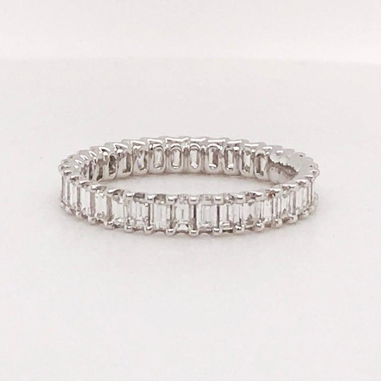 1.50 Carat Emerald Cut Diamond Eternity Band in 18 Karat White Gold Diamond Band For Sale 3