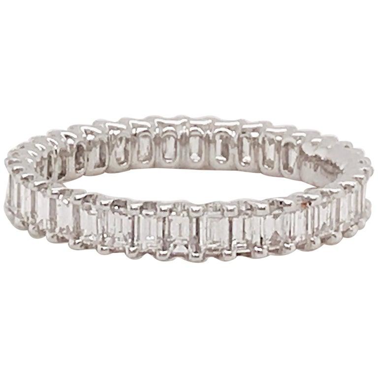 1.50 Carat Emerald Cut Diamond Eternity Band in 18 Karat White Gold Diamond Band For Sale