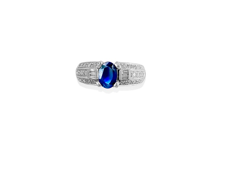 Oval Cut 1.50 Carat Natural Blue Sapphire and Diamond Ring For Sale