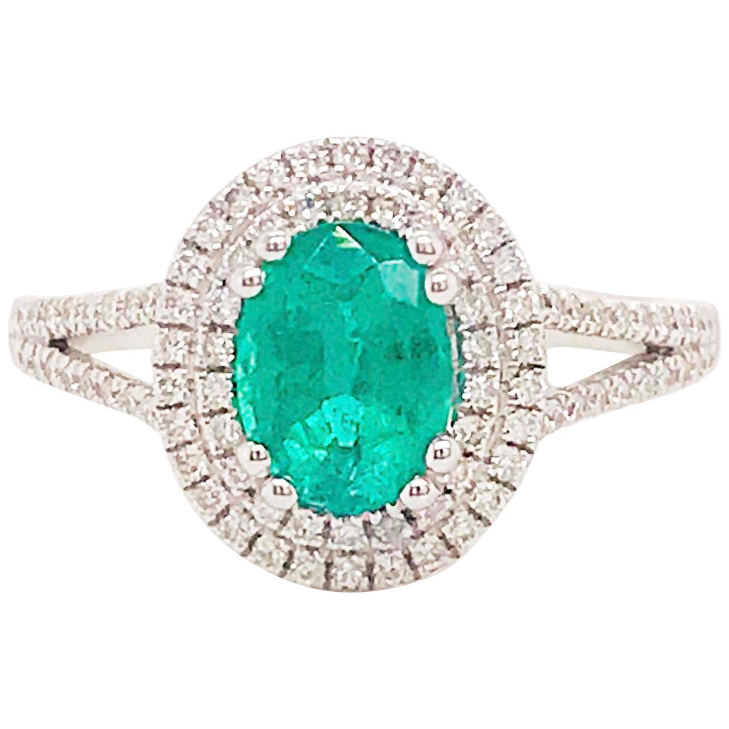 1.50 Carat Oval Emerald and Diamond Halo Engagement Ring White Gold Diamond Band