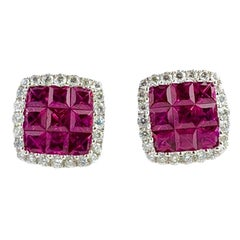 1.50 Carat Ruby and 0.29 Carat Diamond Halo Stud Earrings set in 18 Karat Gold