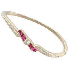 Contemporary 1.50 Carat Ruby and 1.36 Carat Diamond Yellow Gold Bangle
