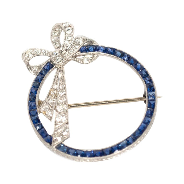 1.50 Carat Total Weight Sapphire Platinum Brooch For Sale