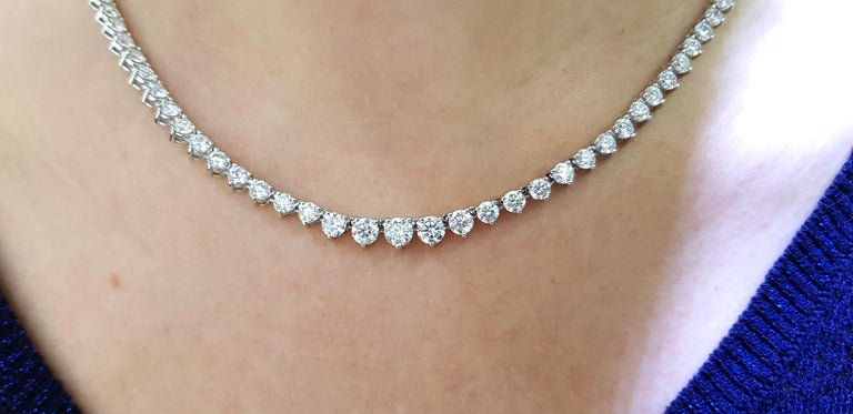 This stunning and impressive Riviera Necklace features total Diamond weight of 15.00 Carats in beautifully graduated Round Brilliant Cut gems with a sparkly white color G/H clarity SI1. Each stone has a three claw setting with open gallery and set