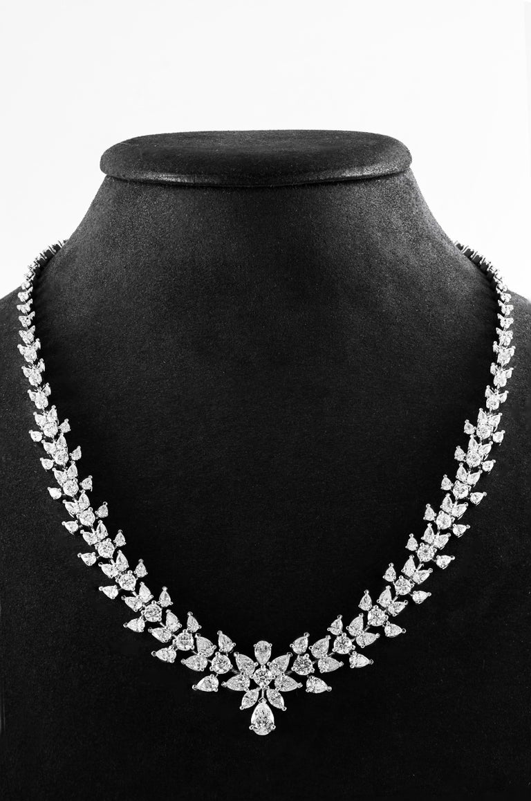 A gorgeous necklace set with 15.08 carats of brilliant round and pear shape diamonds. The size of the diamonds graduate smaller as it goes to the lock. Set in 18k white gold. A timeless piece.   Style available in different price ranges. Prices are