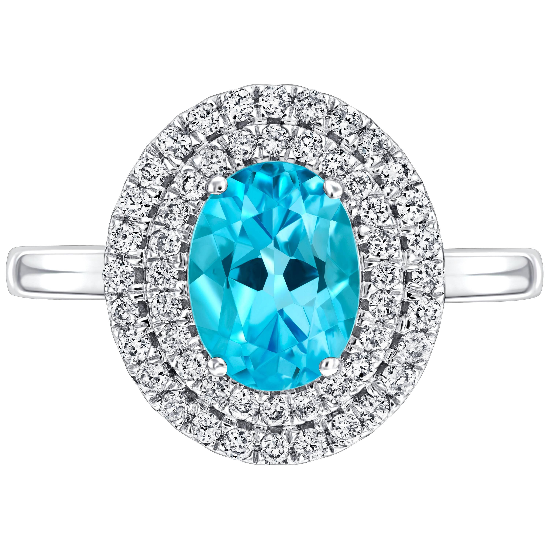 2.02 Carat Oval Blue Topaz Diamond Halo 18 KT White Gold Engagement Ring