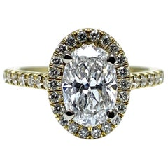 1.51 Carat E SI2 Oval Shaped Diamond with a Diamond Halo and Half Shank
