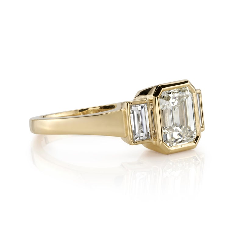 1.51ctw W-X/VS1 GIA certified Emerald cut diamond with 0.47ctw baguette accent diamonds set in a handcrafted 18K yellow gold mounting.  Ring is currently a size 6 and can be sized to fit.