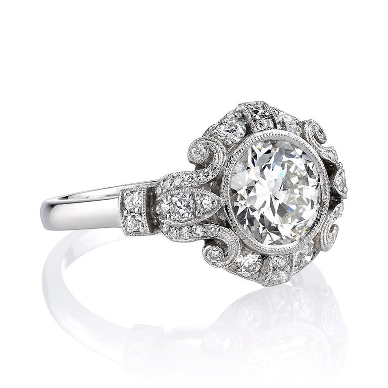 1.51ct I/VS2 EGL Certified Old European cut diamond set in a handcrafted Platinum mounting. An Art Deco design featuring a bezel set diamond and beautiful scroll work.