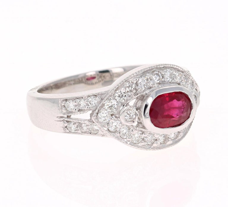 Simply beautiful Ruby Diamond Ring with a Oval Cut 0.92 Carat Burmese Ruby which is surrounded by 34 Round Cut Diamonds that weigh 0.59 carats. The total carat weight of the ring is 1.51 carats. The clarity and color of the diamonds are SI2-F.   The